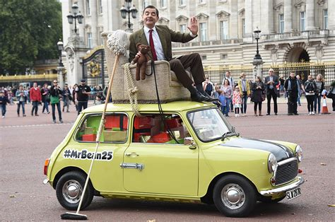 Mr Bean tours London from armchair on top of yellow mini