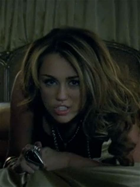 Why does Miley Cyrus writhe around on her bed in her new