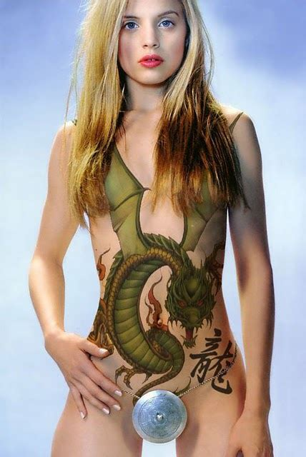 afrenchieforyourthoughts: girl tattoo with dragon tattoos